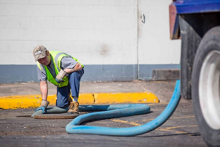 Septic serving serviceman in La Porte pumps a grease tank - La Porte Septic Services - Crown Point Septic Services