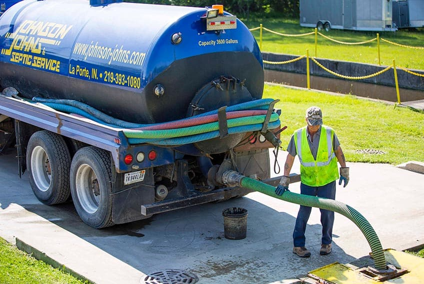 Septic truck being emptied by working man - Plymouth Septic Services